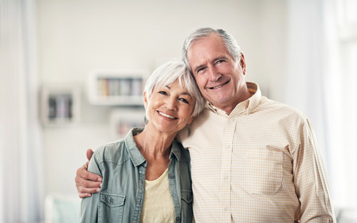 smiling patients with dental implants from Smiles of Tulsa